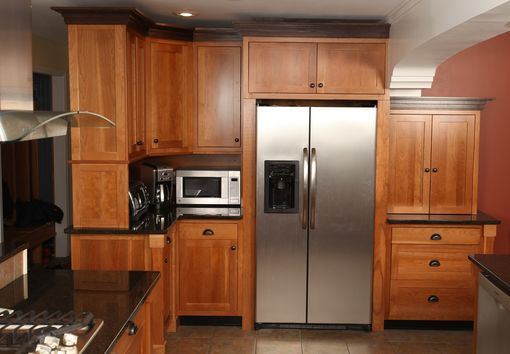 Custom Made Craftsman Style Kitchen In Cherry With Black Walnut Crown.