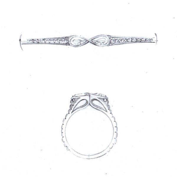 Our sketches for a ring design with pear cut gems nestled into an infinity setting.
