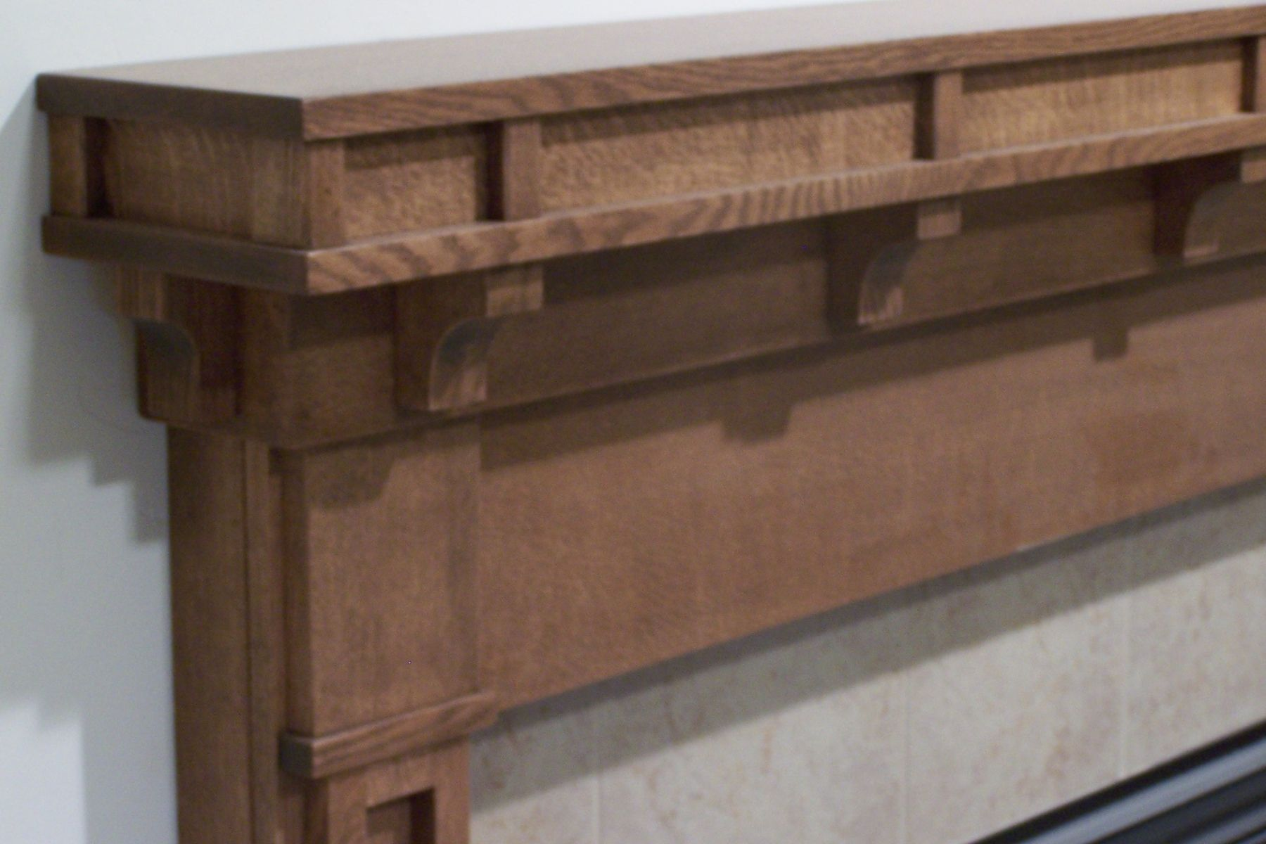 handmade craftsman style fireplace surround by custom woodgrains