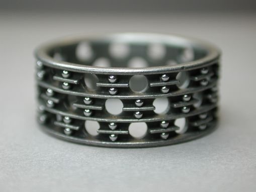 Custom Made Titanium Band With Alternating Perforations And Stainless Balls
