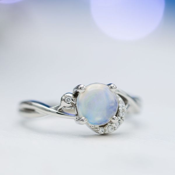 This semi-translucent opal shows a pale blue hue reminiscent of a moonstone.