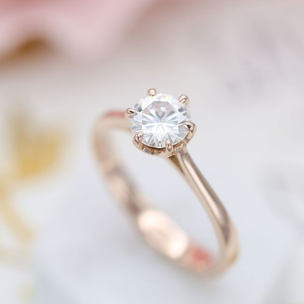 A six-prong setting for this delicate solitaire gives it a bit of extra security and a slightly vintage feel.