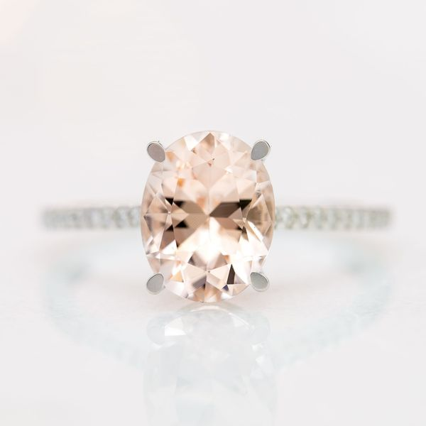 An oval morganite at the peach/salmon side of the color spectrum. Just a hint of blush. Pairing it with white gold reinforces that crisp, bright look.