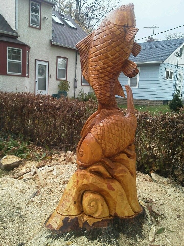 Handmade koi garden sculpture by curtis chainsaw