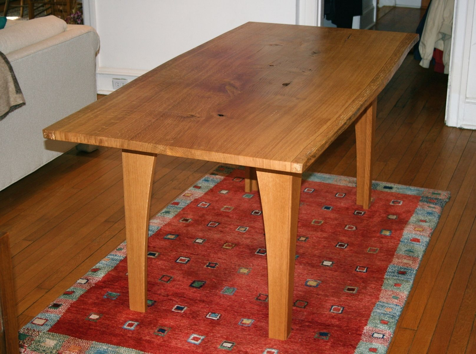 Custom made dining table of distressed white oak live edge