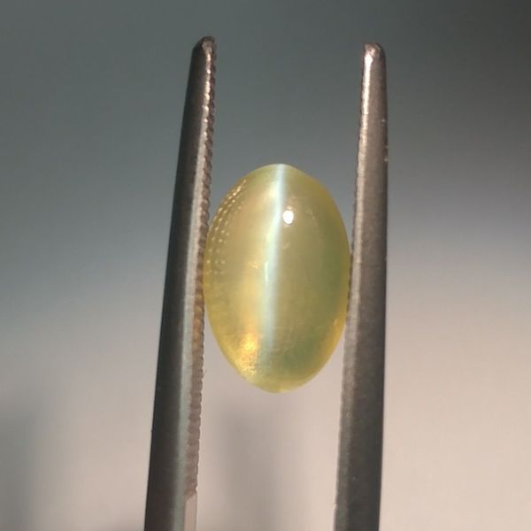 Cat's eye chrysoberyl shows a distinctive line across its shimmering surface.