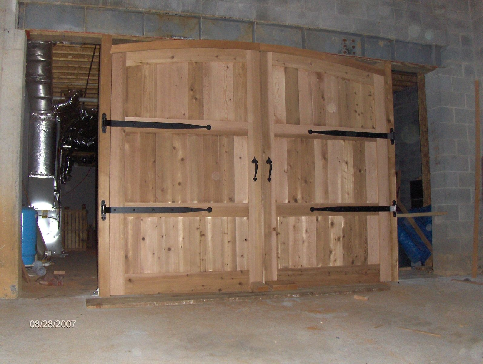 Hand crafted cedar garage doors by paradigm wood designs for Custom made wood doors