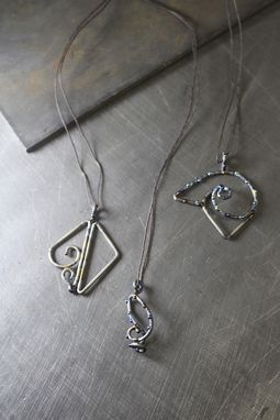Custom Made Welded Titanium Pendants