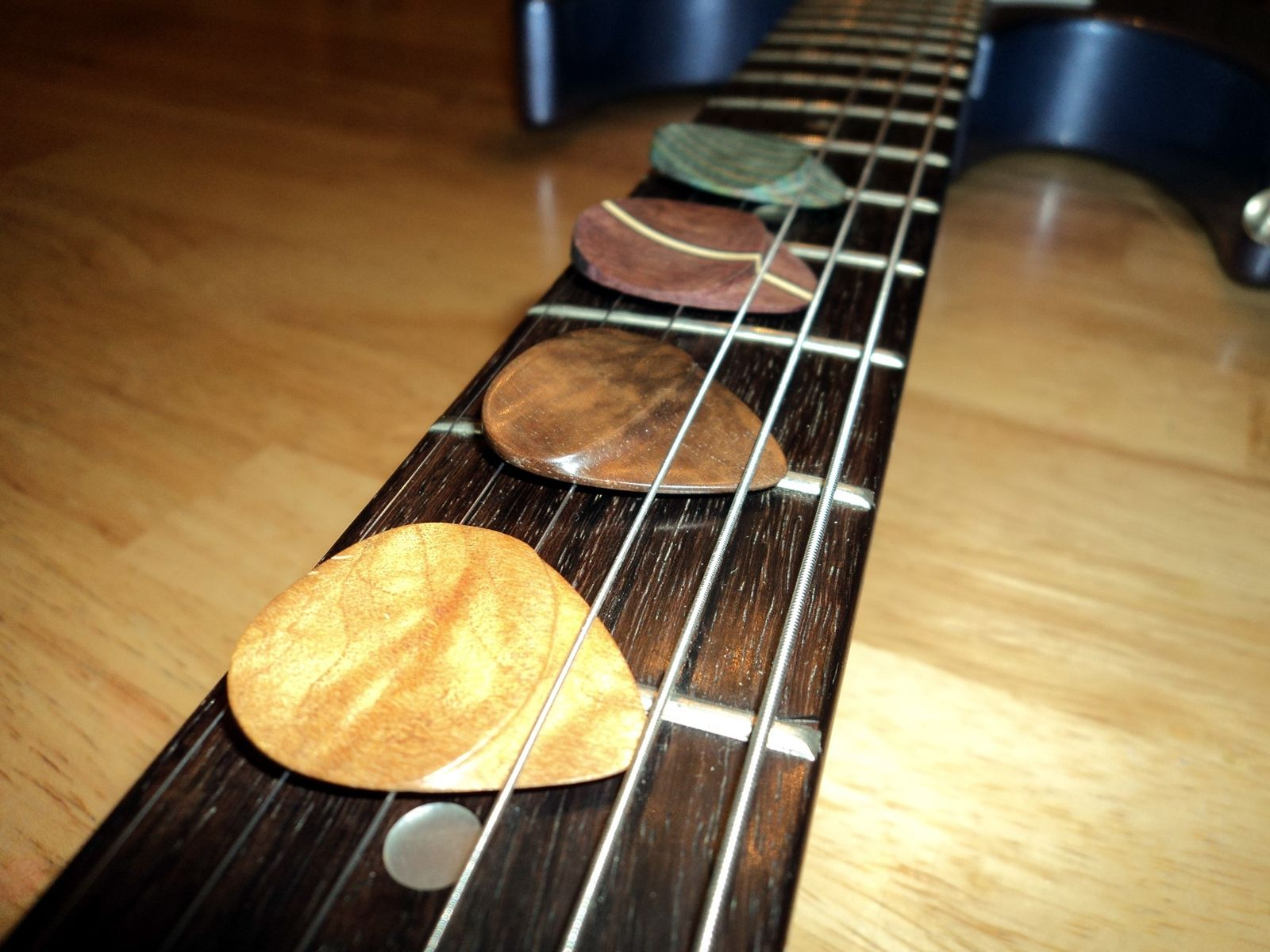 Custom Wooden Guitar Picks With Hand Shaped Thumb Grip by Sandman