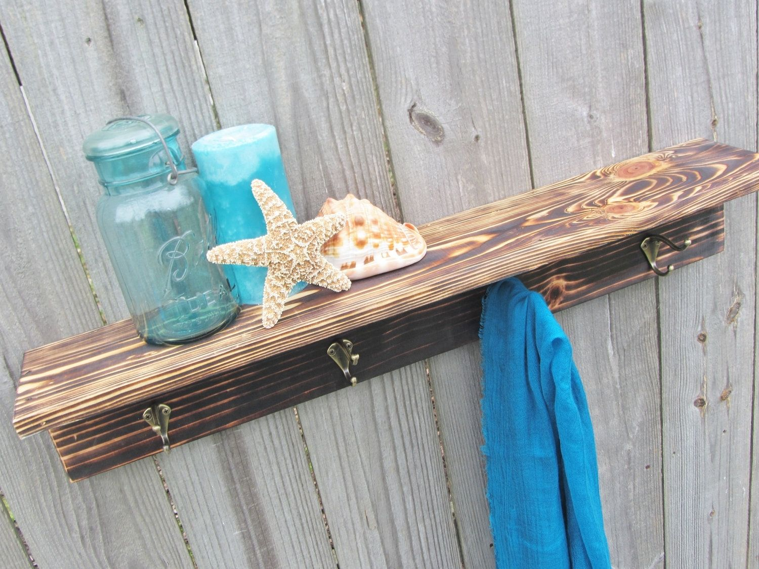 Custom rustic wood shelf with hooks made from reclaimed