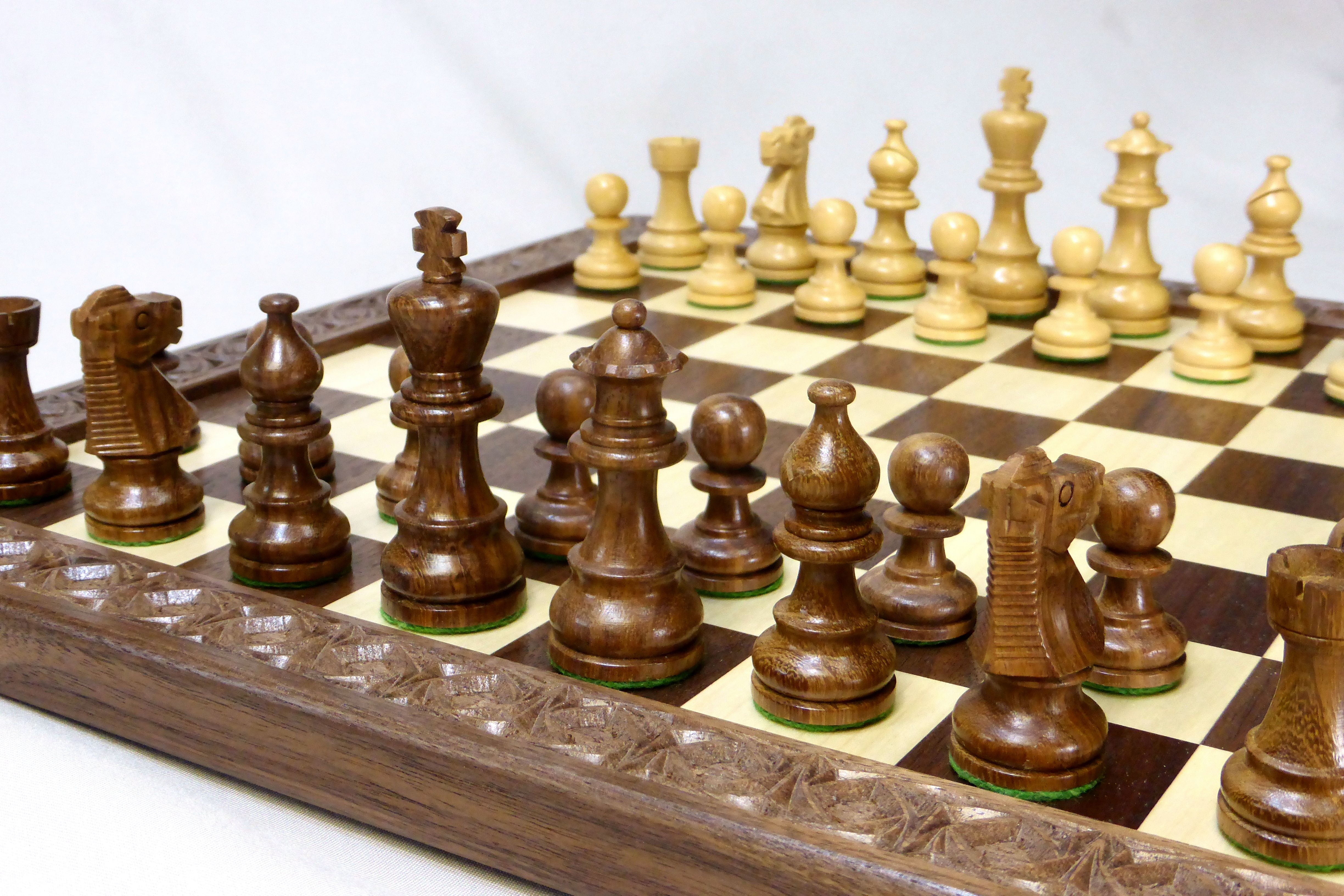 Custom made walnut and maple checkers chess board with carved border