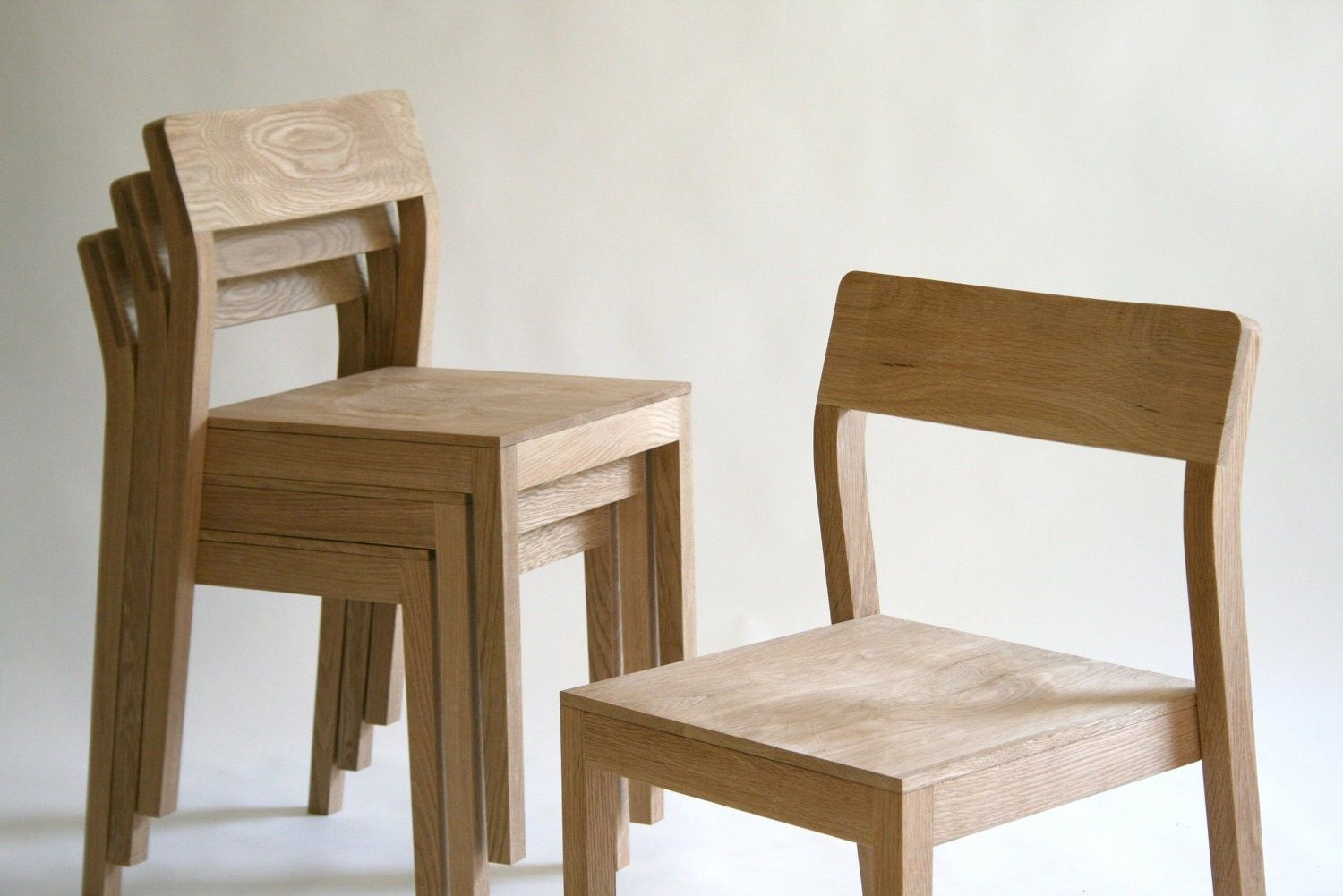 Hand made stackable wood dining chair by kapel designs for Stackable dining room chairs