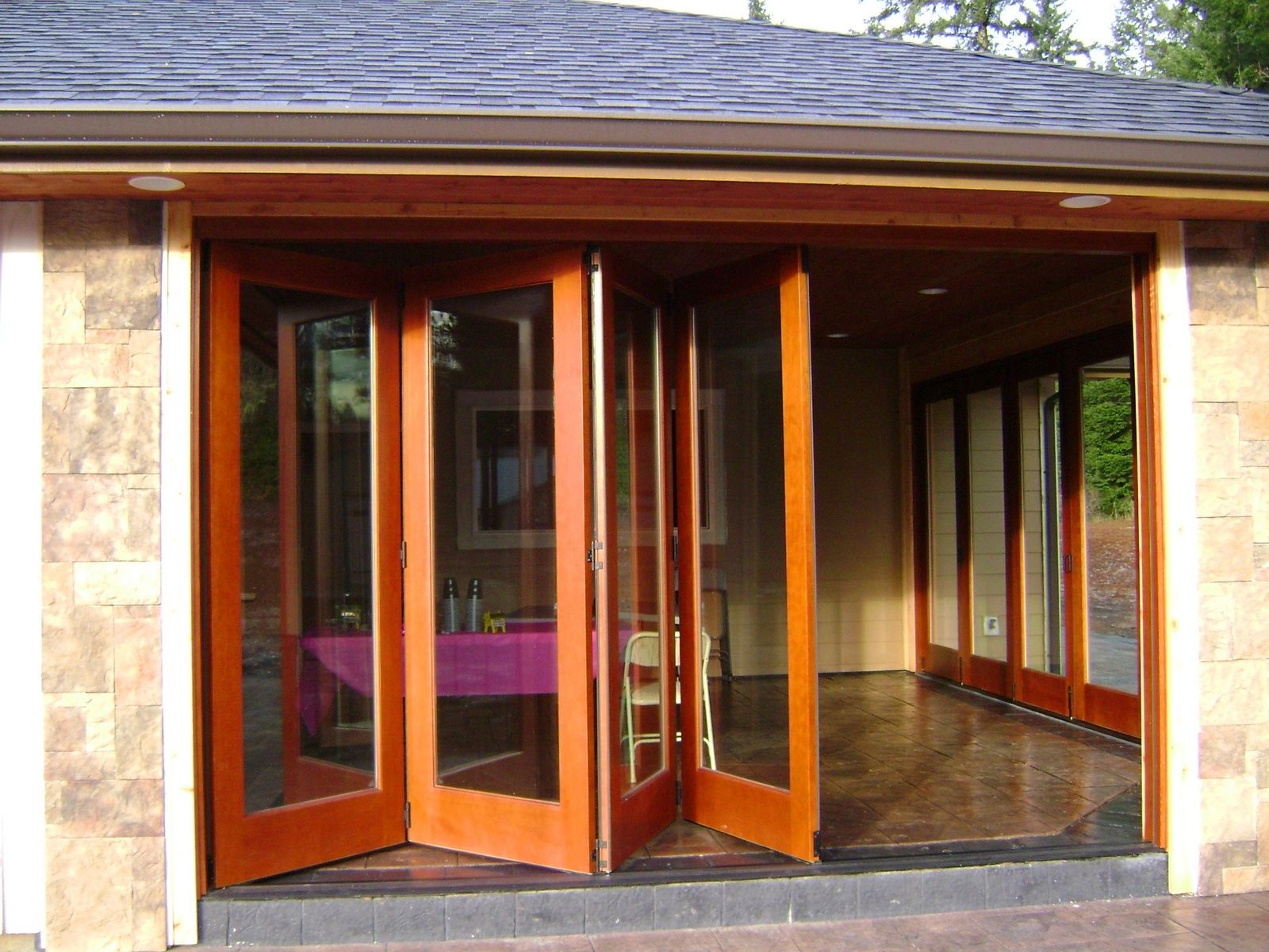 Handmade folding exterior wood window walls by lacey door for Wood doors with windows