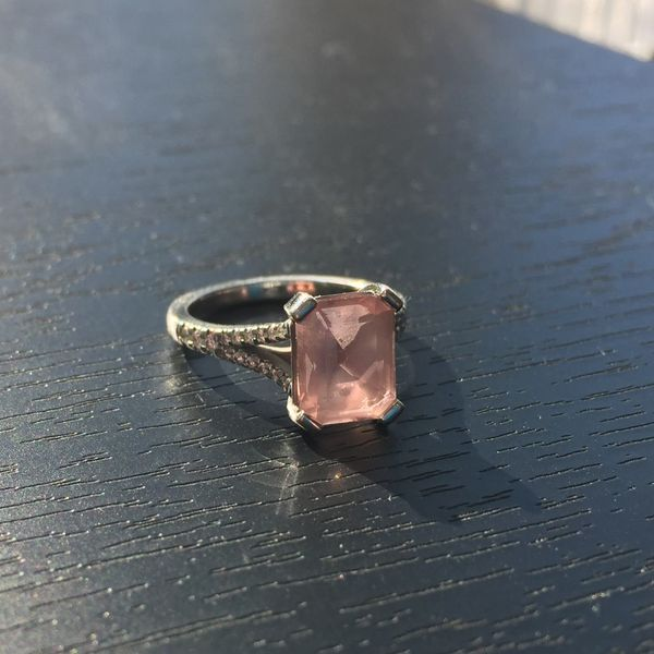 This morganite has clouded over with oils and chemicals it's picked up with daily wear.