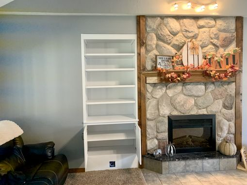 Custom Made Built-In Shelving And Base Cabinet With Doors