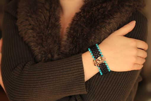 Custom Made Touch-Of-Turquoise Hand Woven Black Onyx Flower Bracelet With Filigree Clasp
