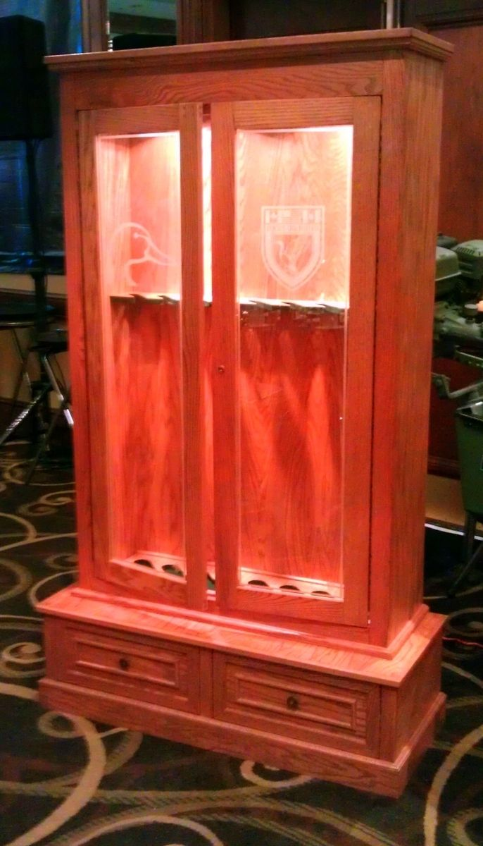 Hand Crafted Custom Lighted Oak Gun Cabinet By Ambassador