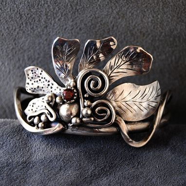Custom Made Stylized Flower Bracelet With Garnet