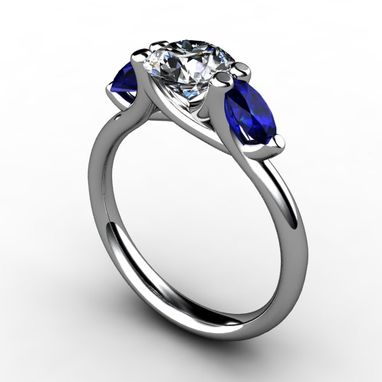 Custom Made Three Stone Round Diamond Center With Blue Marquise Sapphires
