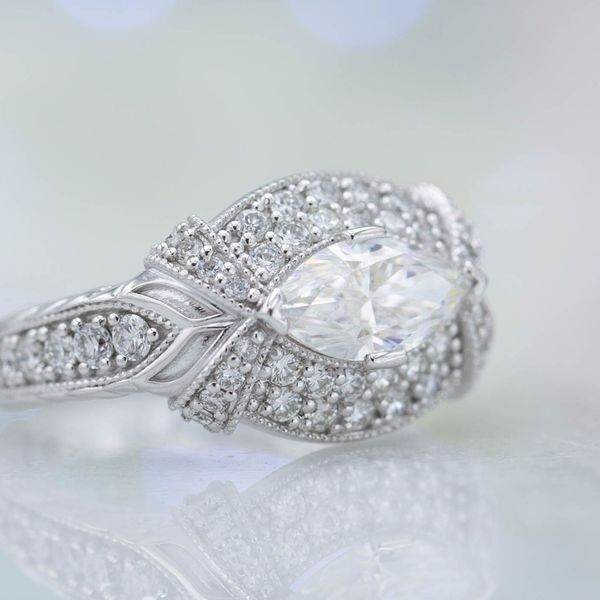 Vintage-inspired ring with east-west set marquise diamond and tons of sparkling accent stones.
