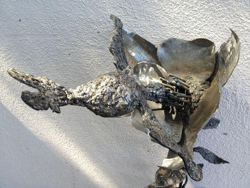 Custom Made Metal Sculpture Of A Hummingbird Drinking From A Columbine Flower