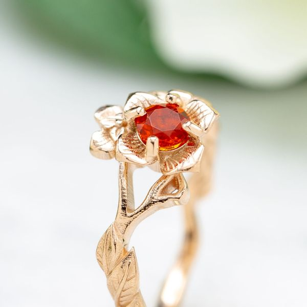 A cherry red fire opal adds a pop of bright color to this delicate, rose gold band inspired by the persimmon blossom.