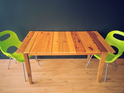 Custom Made Eight Wood Species Dining Table