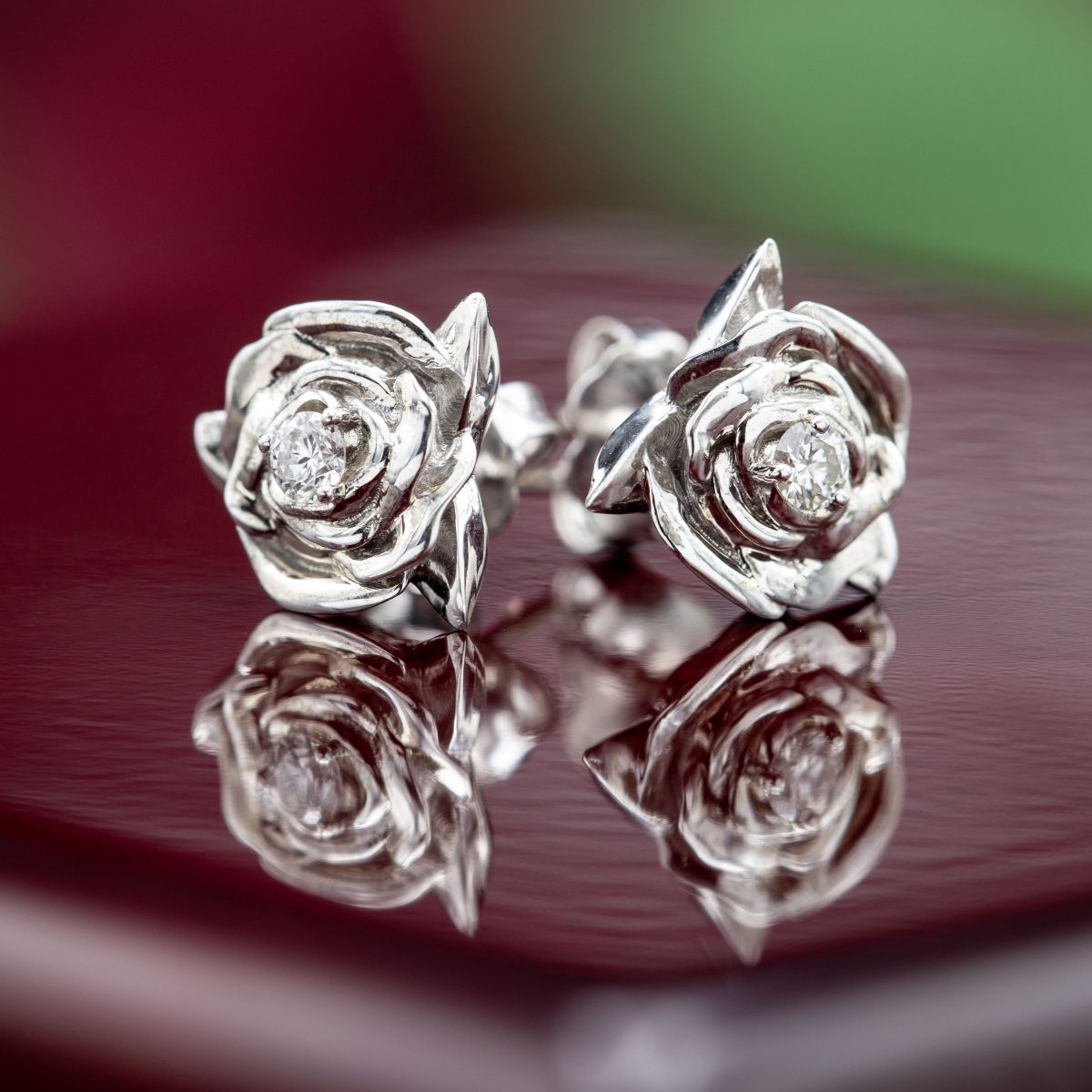 Sculptural Rose Studs In White Gold With Diamond Centers Tucked Into The Petals