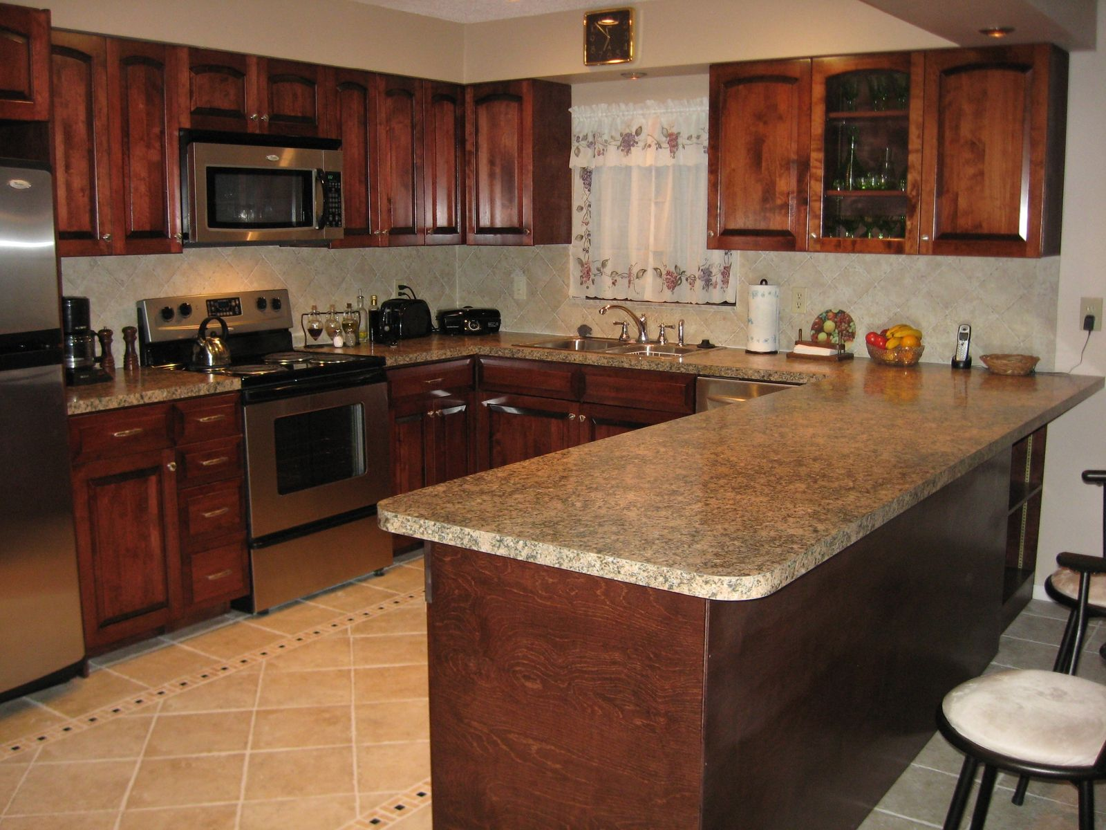 Handmade birch kitchen by gideon 39 s cabinet trim for Arch kitchen cabinets