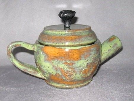 Custom Made Ceramic/Stoneware Teapot With A Leaf Knob On The Top And Strainer Holes For Loose Tea