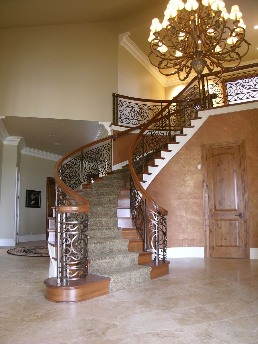 Custom Iron And Cherry Curved Staircase By Master