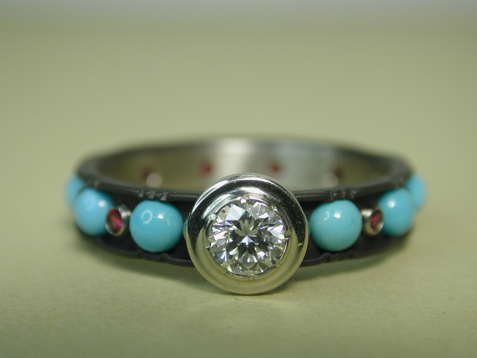 Custom Made Diamond Solitaire Ring On Anium Band With Turquoise And Rubies