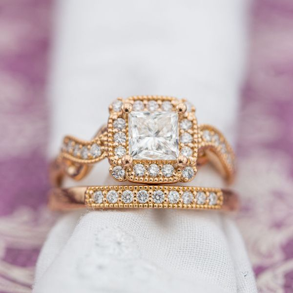 Princess cut diamond and engagement ring with cushion halo and infinity symbols.