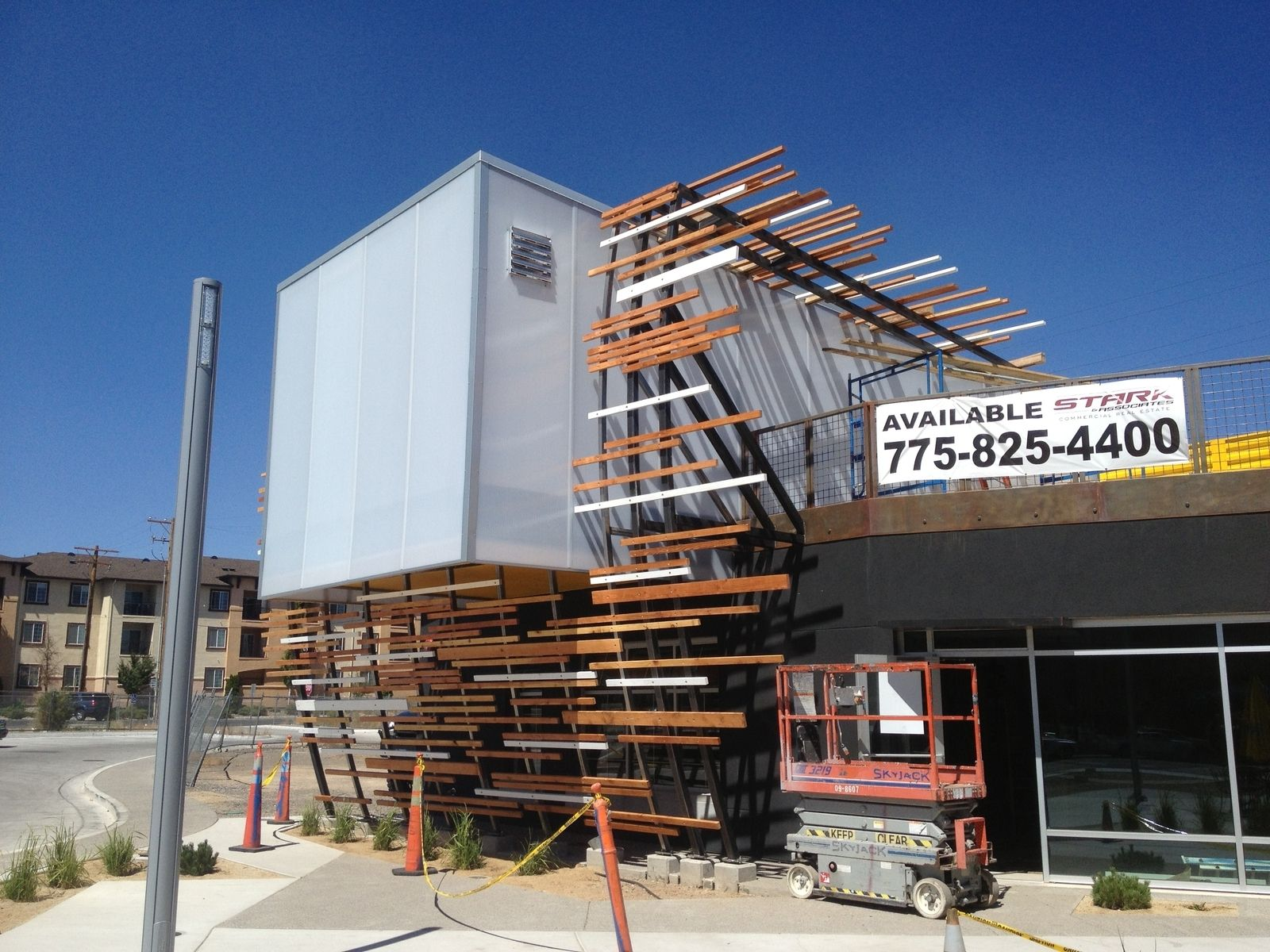 Custom Vertical Steel Trellis With Wood On Store Front By