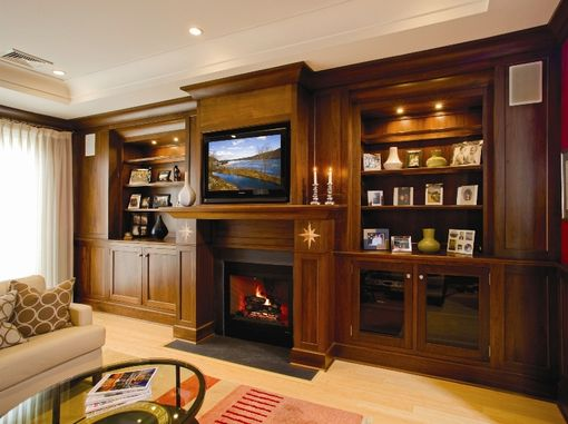 Custom Made Built In Book Shelves And Entertainment Center With Fireplace Surround
