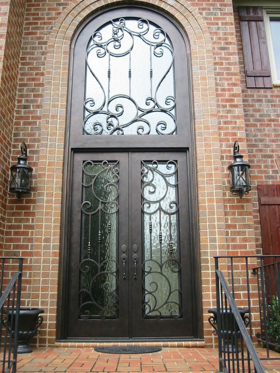 Hand made wrought iron door by the looking glass for Decorative entrance doors
