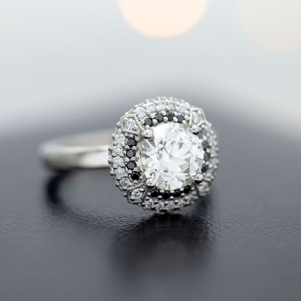 Deco-inspired double halo engagement ring with an old European cut diamond center stone.