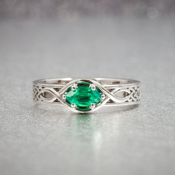 This Celtic-inspired rope design seems to unwind and open up into the perfect setting for a marquise-cut emerald.