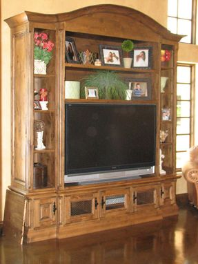 Custom Made Entertainment Center With Curved Crown