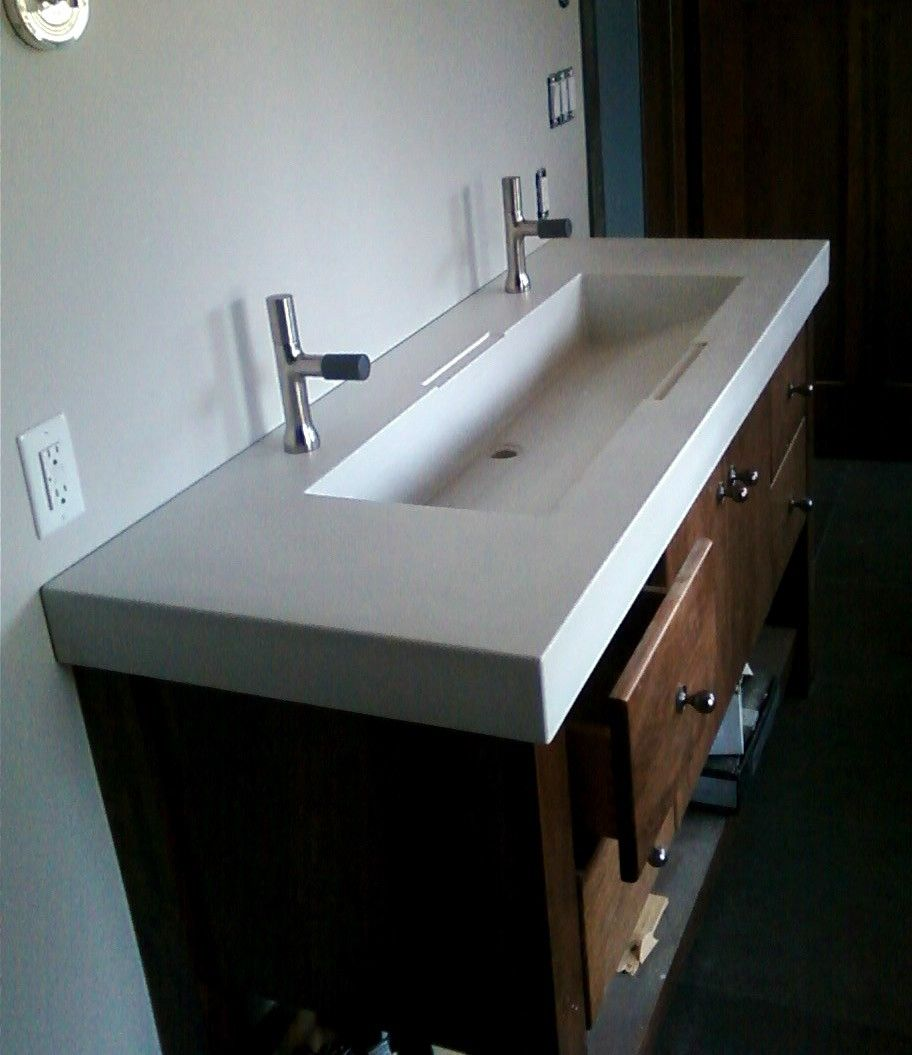 Hand crafted custom concrete sinks by masonry and metal l for Custom bathroom design