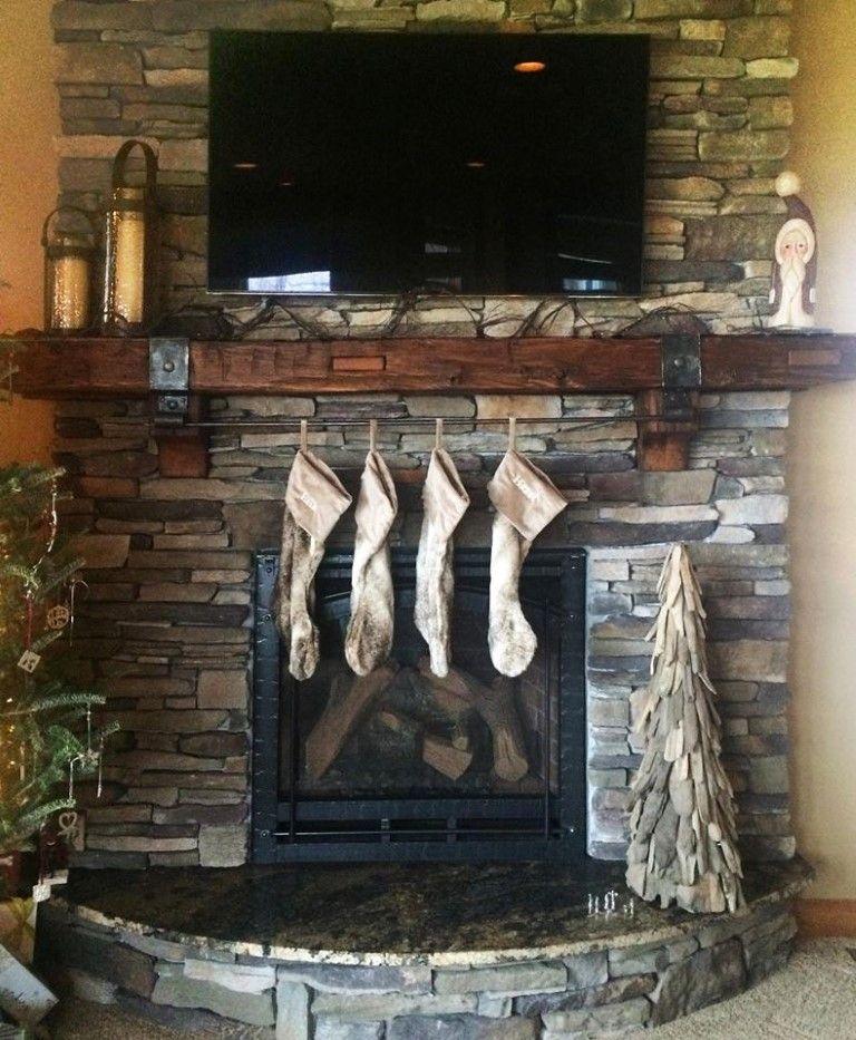 Custom Hand Hewn Mantel With Christmas Stocking Ironwork