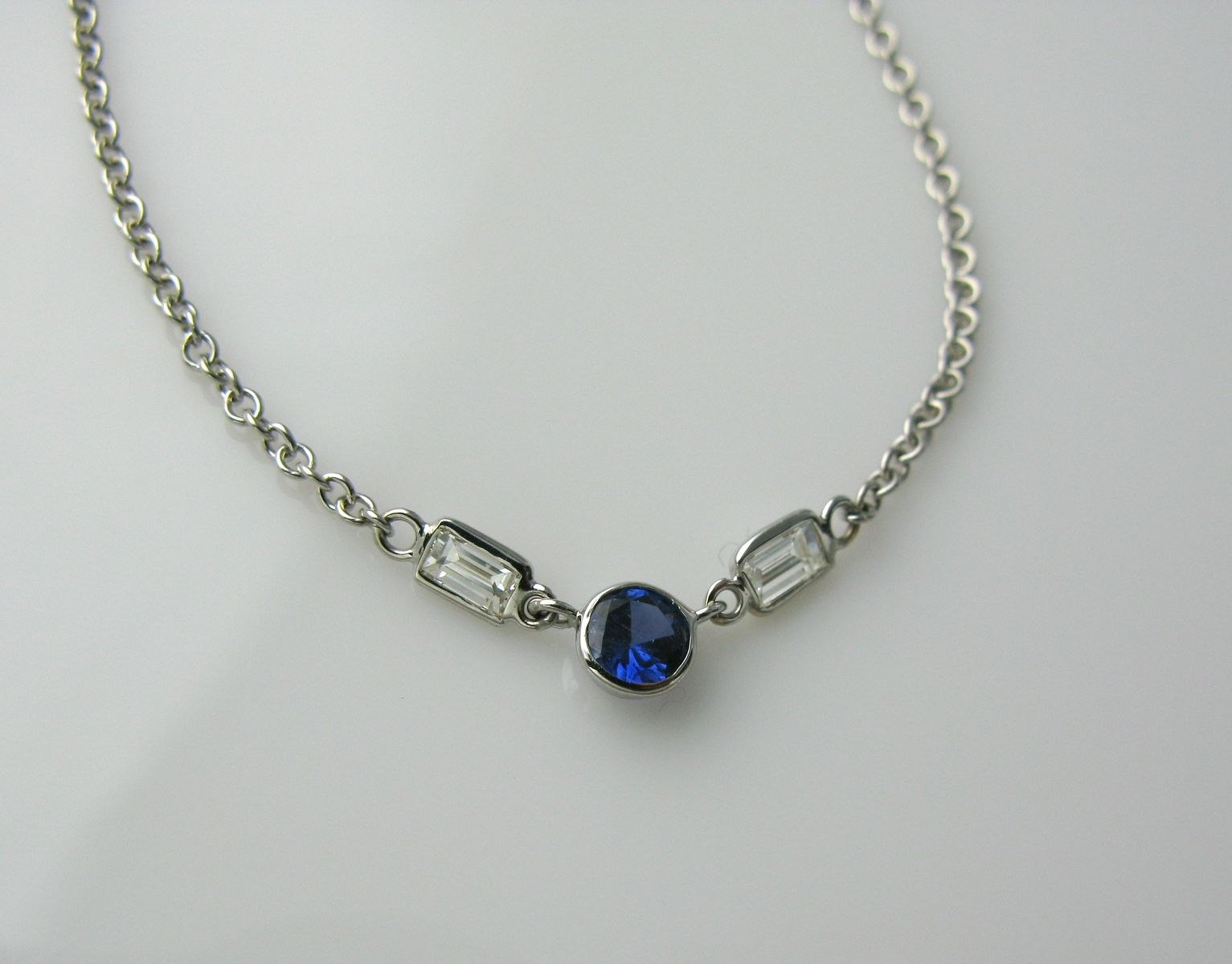 Hand made blue sapphire and diamond baguette necklace by for Man made sapphire jewelry