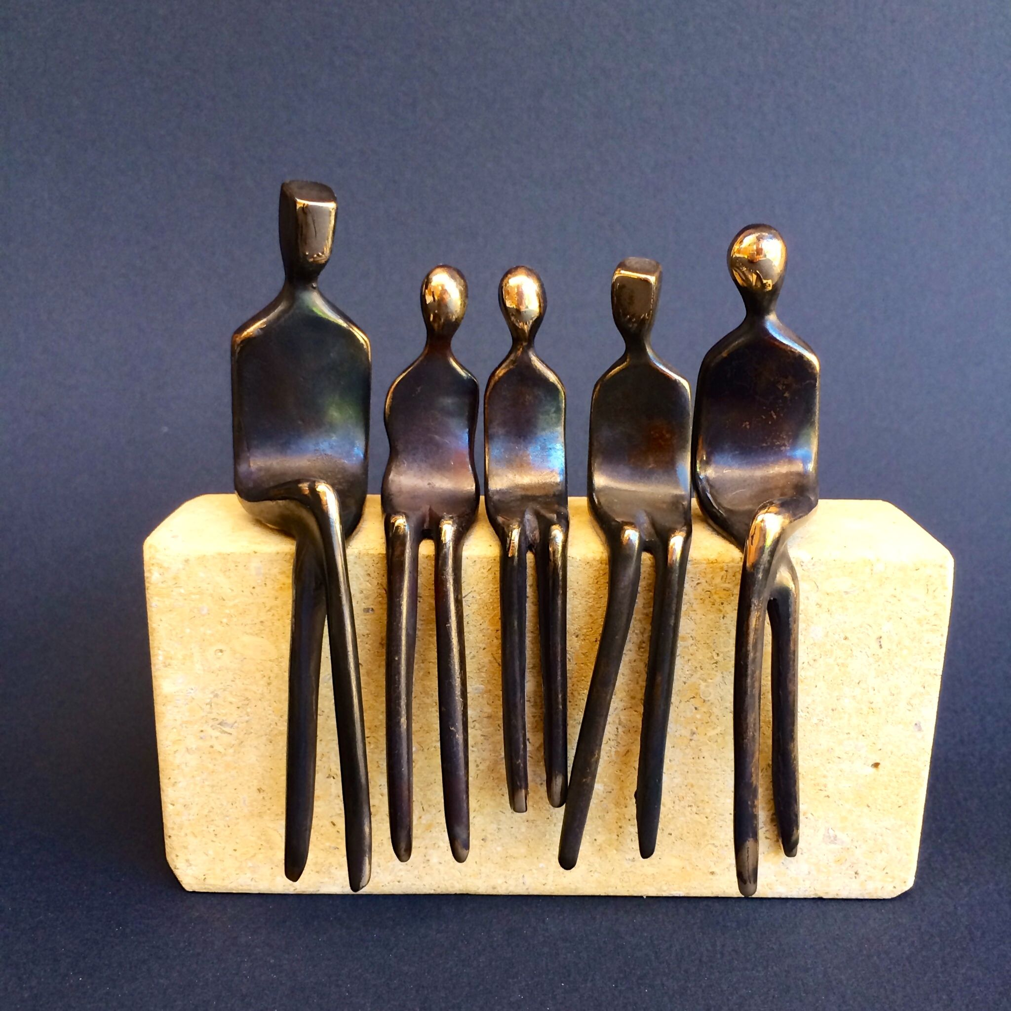 custom bronze sculpture family of four by yenny cocq sculpture llc