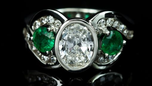 Custom Made Oval Diamond With Emeralds