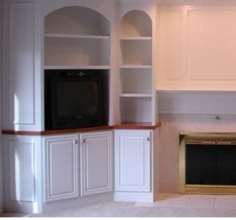 Hand Crafted Built In With Arches And Corner Cabinet By