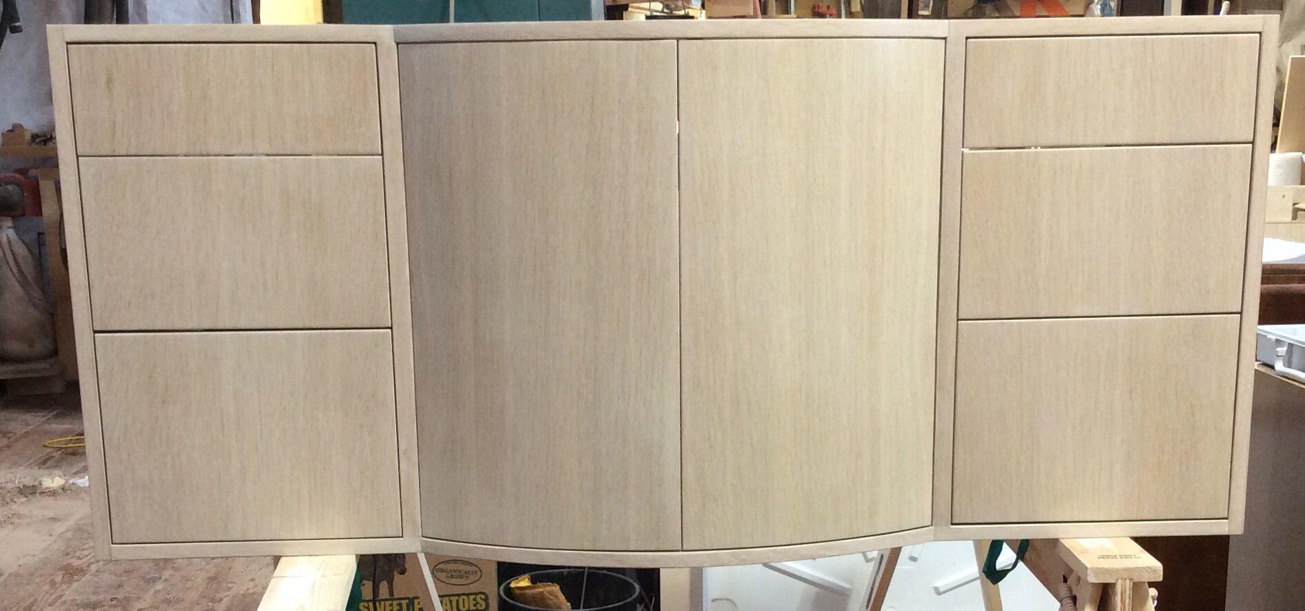 Custom Floating Whitewashed Oak Vanity With Curved Doors