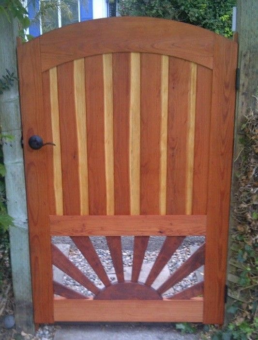 Custom Arched Redwood Gate With Sunburst Pattern By