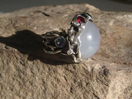 Custom Made Entertwined Silver Ring With Moonstone, Sapphire, And Rubies