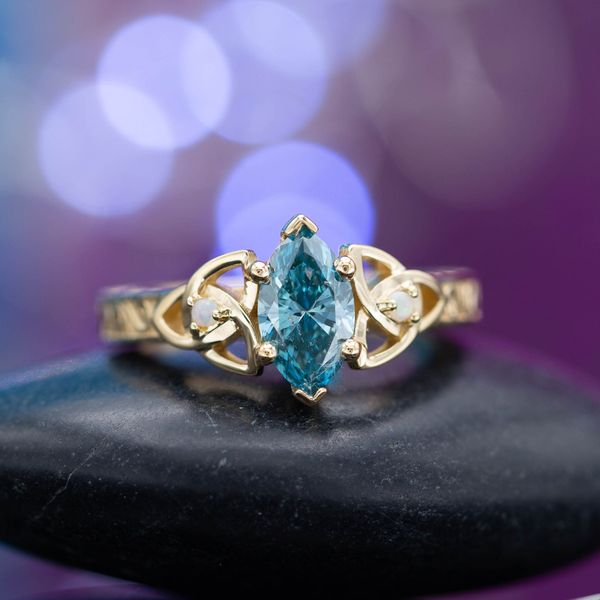 Fancy colored diamonds, like this vivid blue marquise cut diamond, make for a rare and beautiful center stone.