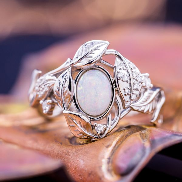 This Australian white opal has beautiful, but subtle color flash on a white body.